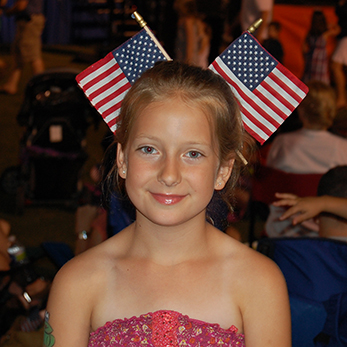4th of July girl with flags